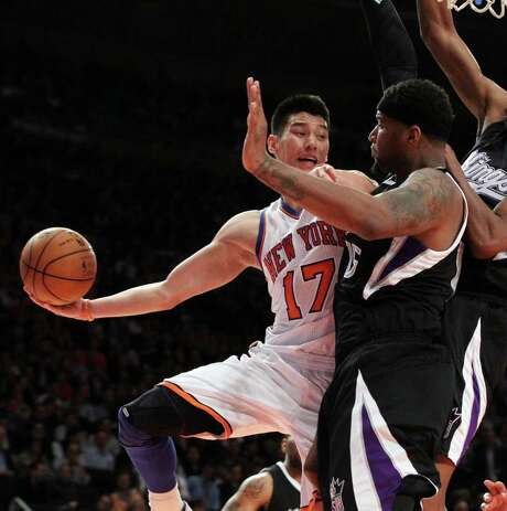 Knicks sensation Jeremy Lin foiled the defensive efforts of the Kings by dishing out a career-high 13 assists on Wednesday night. Photo: Jim McIsaac / Newsday