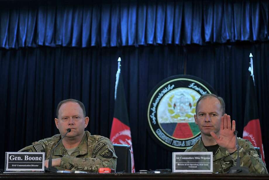 "British Air Commodore Mike Wigston (R) talks during a press conference as General Boone International Security Assistance Force (ISAF) communication director looks in Kabul on February 15, 2012. The US-led NATO force in Afghanistan on February 15 conceded that eight young men were killed during a recent air strike but insisted they were armed teenagers who posed a ""threat"" to soldiers. Afghan President Hamid Karzai condemned the air strikes in the northeastern province of Kapisa, where French troops are based, and ordered an investigation after saying that eight children were killed on February 8. Photo: Shah Marai, AFP/Getty Images"