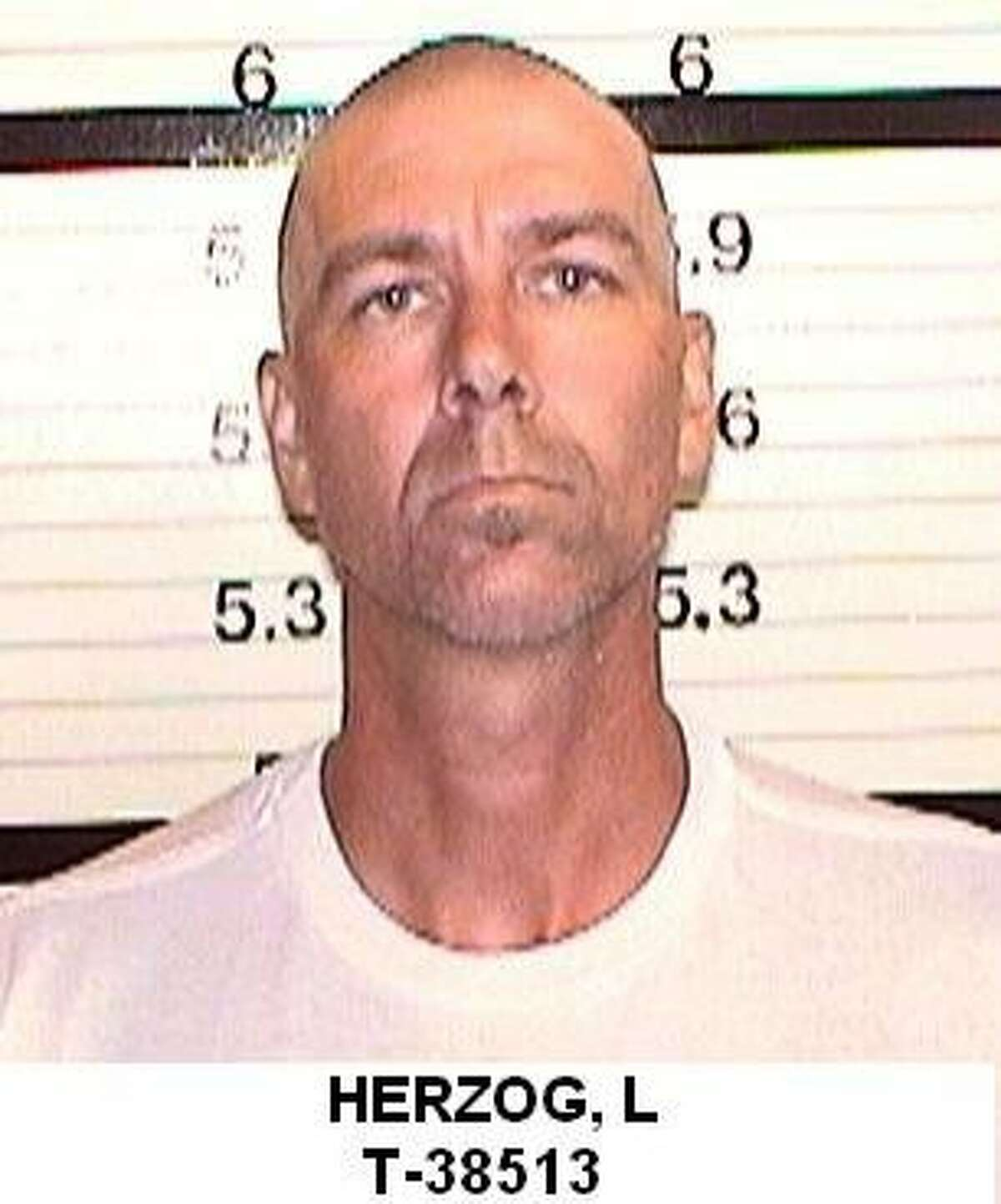 """In this undated file photo provided by the California Department of Corrections shows Loren Joseph Herzog. Authorities say Herzog and Wesley Shermantine, dubbed the """"Speed Freak Killers,"""" wantonly murdered many throughout California's rural Central Valley before their arrest in 1999. Now, motivated by a bounty hunter's promise to pay, one of those convicted killer's is breaking his long-held secret and leading investigators to burial sites that have yielded hundreds of human bones."""