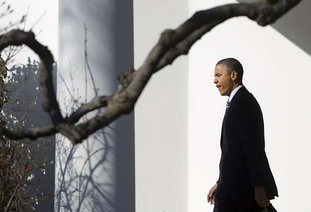 President Barack Obama walks from the Oval Office of the White House in Washington, Wednesday, Feb. 15, 2012, to board Marine One, as he travels to Wisconsin. Photo: Carolyn Kaster, Associated Press