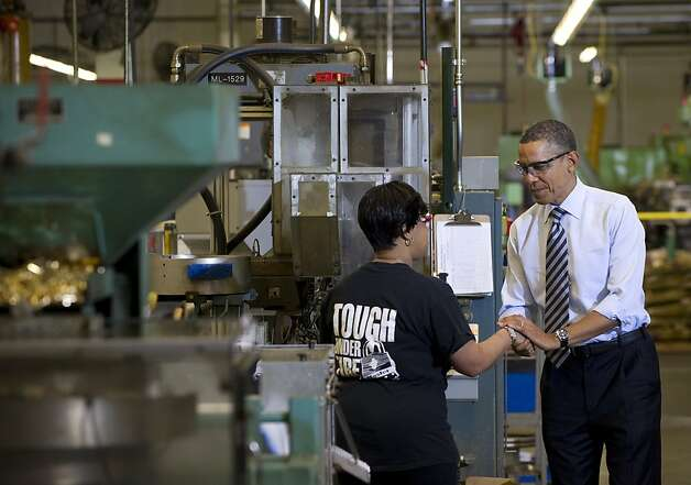 US President Barack Obama speaks with an employee as he tours the manufacturing facility at Master Lock, maker of security locks, prior to speaking on the economy in Milwaukee, Wisconsin, on February 15, 2012. Photo: Saul Loeb, AFP/Getty Images
