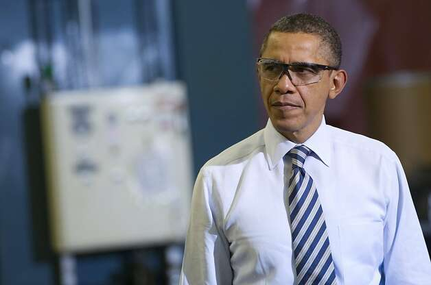 US President Barack Obama tours the manufacturing facility at Master Lock, maker of security locks, prior to speaking on the economy in Milwaukee, Wisconsin, February 15, 2012. Photo: Saul Loeb, AFP/Getty Images