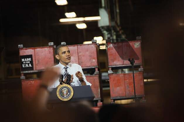 U.S. President Barack Obama speaks to workers at the Master Lock factory on February 15, 2012 in Milwaukee, Wisconsin. Obama applauded the company, which he cited in his State of the Union address, for bringing back 100 jobs to the U.S. from China. Photo: Scott Olson, Getty Images