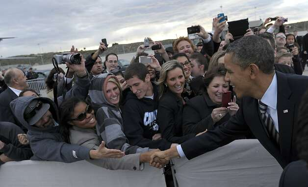 President Barack Obama greets people as he arrives at Los Angeles International Airport in Los Angeles, Wednesday, Feb. 15, 2012. Obama is on a three-day trip to the West Coast. Photo: Susan Walsh, Associated Press
