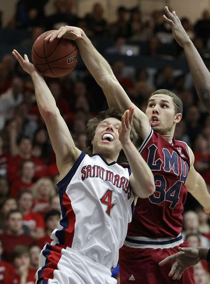 Saint Marys guard Matthew Dellavedova (4) has his shot blocked by Loyola Marymount forward Drew Viney (34) in the first half of an NCAA college basketball game Wednesday, Feb. 15, 2012, in Moraga, Calif. (AP Photo/Ben Margot) Photo: Ben Margot, Associated Press