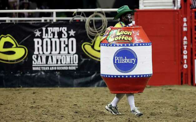 Rodeo clown Leon Coffee walks inside his barrel during a break in the bull riding competition at the 2010 San Antonio Stock Show & Rodeo and Lady Antebellum concert on Friday, Feb. 5, 2010. Photo: Kin Man Hui, San Antonio Express-News File Photo / San Antonio Express-News