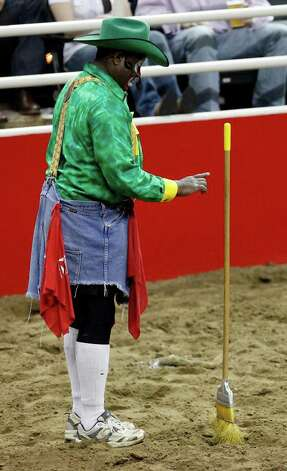 Legendary rodeo clown Leon Coffee amuses the crowd during a break in rodeo action at the 60th Annual San Antonio Stock Show & Rodeo on Feb. 6, 2009. Photo: KIN MAN HUI, San Antonio Express-News File Photo / kmhui@express-news.net