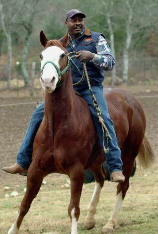 Leon Coffee  rides  his favorite horse Boss at his ranch near Blanco on Jan. 14, 2004. Photo: TOM REEL, San Antonio Express-News File Photo / SAN ANTONIO EXPRESS-NEWS