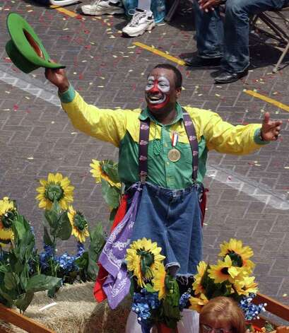 Leon Coffee waves to the crowd as the 2005 Battle of Flowers Parade Grand Marshal as the parade passes through Alamo Plaza on Friday, April 22, 2003. Photo: EDWARD ORNELAS, San Antonio Express-News File Photo / SAN ANTONIO EXPRESS-NEWS