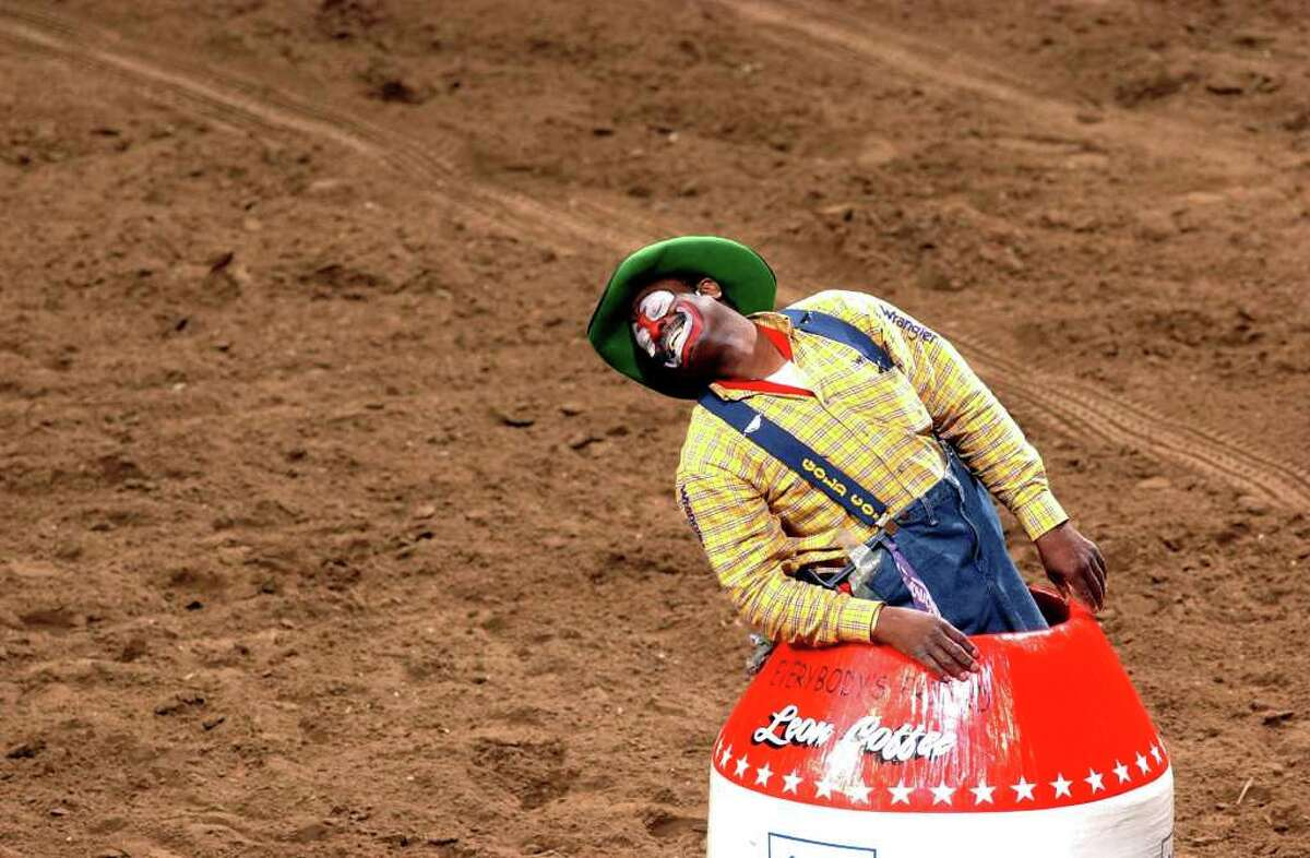 Rodeo clown Leon Coffee plays with the crowd between bull riding competitors at the San Antonio Stock Show & Rodeo on Monday, Feb. 14, 2005.