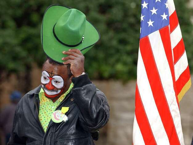 Rodeo clown Leon Coffee tips his hat during a press conference annoucing him as Grand Marshal of the Battle of Flowers parade on Thursday, Jan. 6, 2005 in Alamo Plaza. Photo: EDWARD A. ORNELAS, San Antonio Express-News File Photo / SAN ANTONIO EXPRESS-NEWS