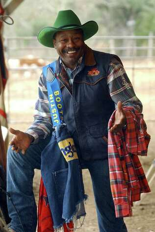 Leon Coffee shows some of his rodeo gear while talking in a barn at his ranch near Blanco on Jan. 14, 2004. Photo: TOM REEL, San Antonio Express-News File Photo / SAN ANTONIO EXPRESS-NEWS