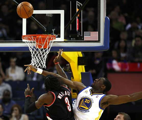 Golden State Warriors' Ekpe Udoh blocks a shot by Portland Trail Blazers Gerald Wallace during the first half of an NBA basketball game, Wednesday, February. 15, 2012, in Oakland, Calif. Photo: Lance Iversen, The Chronicle