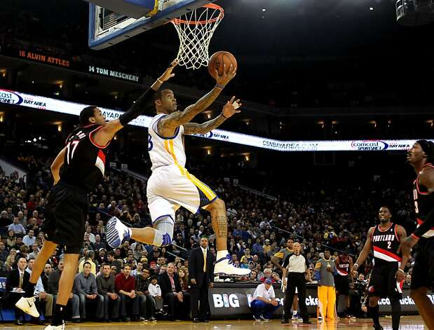 Golden State Warriors' Monta Ellis drives for the basket past Portland Trail Blazers Chris Johnson during the first half of an NBA basketball game, Wednesday, February. 15, 2012, in Oakland, Calif. Photo: Lance Iversen, The Chronicle