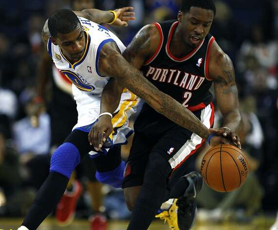 Golden State Warriors' Dorell Wright reaches in to make the ball away from   Portland Trail Blazers Wesley Matthews during the first half of an NBA basketball game, Wednesday, February 15, 2012, in Oakland, Calif. Photo: Lance Iversen, The Chronicle