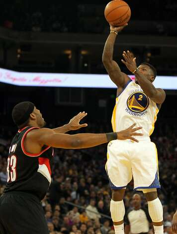 Golden State Warriors' Nate Robinson scores over Portland Trail Blazers Craig Smith during the first half of an NBA basketball game, Wednesday, February 15, 2012, in Oakland, Calif. Photo: Lance Iversen, The Chronicle