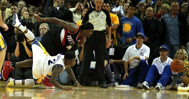 Golden State Warriors' Nate Robinson loses control of the ball as the clock ran out on the Warriors during the second half of an NBA basketball game, Wednesday, February 15, 2012, in Oakland, Calif. The Trail Blazers beat  the Warriors beat 93-91. Photo: Lance Iversen, The Chronicle