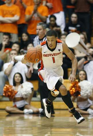 Oregon State guard Jared Cunningham (1) brings the ball up court in the second half during an NCAA college basketball game with Washington State Thursday, Feb. 9, 2012, in Corvallis, Ore. Photo: Rick Bowmer, Associated Press