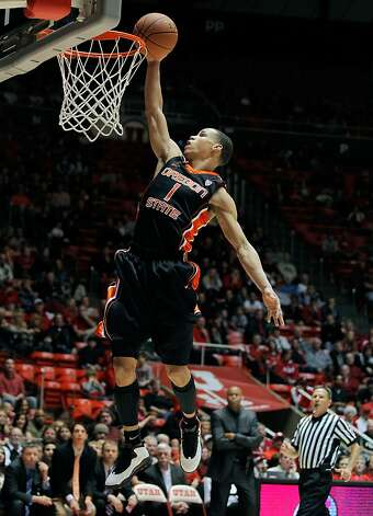 Oregon State guard Jared Cunningham (1) gets downcourt for a dunk off a fast break during the second half of their NCAA college basketball game against Utah in Salt Lake City, Saturday, Feb. 4, 2012. Oregon State defeated Utah 76-58. Photo: Steve C. Wilson, Associated Press