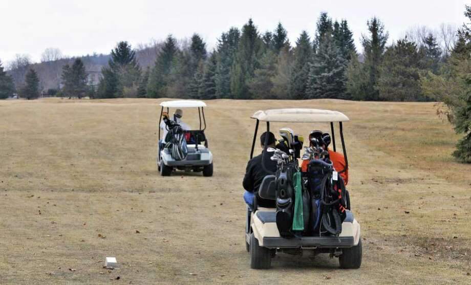 Early season golfers at Evergreen Country Club in Schodack Wednesday Feb. 15, 2012.   (John Carl D'Annibale / Times Union) Photo: John Carl D'Annibale / 00016447A