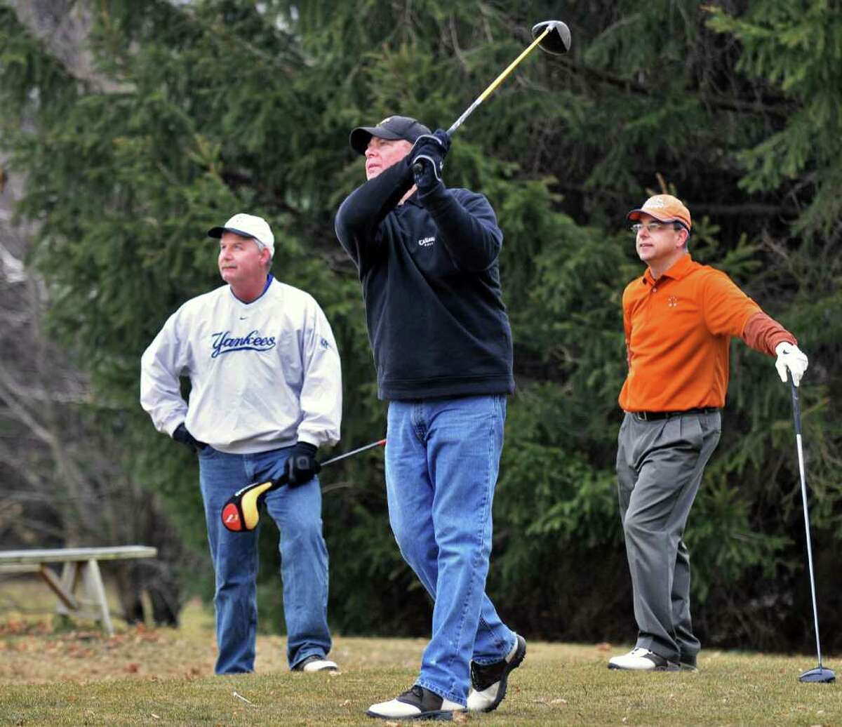 Early season golfers, from left, Tim Mardon, Mark Bowman and Tim Mosher, all of Poestenkill, at Evergreen Country Club in Schodack Wednesday Feb. 15, 2012. (John Carl D'Annibale / Times Union)