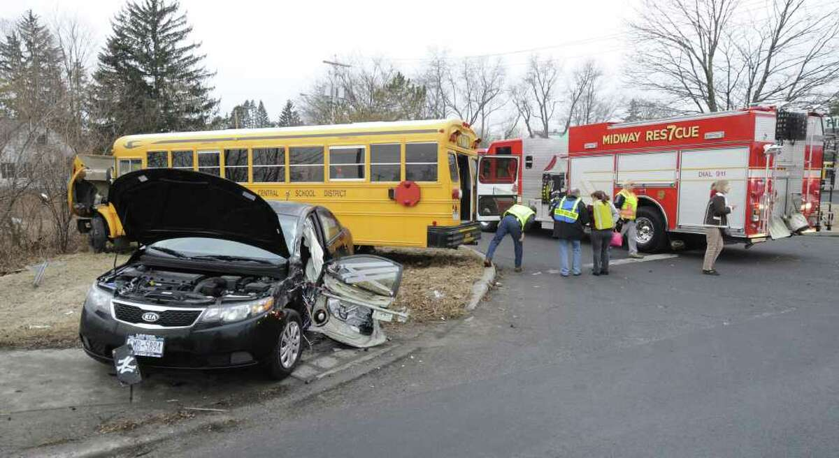 Colonie police investigate an accident that occurred at the intersection of Kendale Avenue and Central Avenue in Colonie, N.Y. The wreck involved a sedan and a school bus with students on board on Thursday, Feb. 16, 2012. ( Skip Dickstein / Times Union)