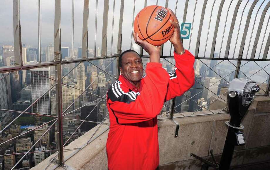 """The Empire State Building hosts legendary Harlem Globetrotter and Basket Ball of Famer Meadowlark Lemon as he promotes his new book, """"Trust Your Next Shot: A Guide To A Life Of Joy."""" He spoke at Fairfield University on Monday, Feb. 13. Photo: Contributed Photo / Connecticut Post Contributed"""