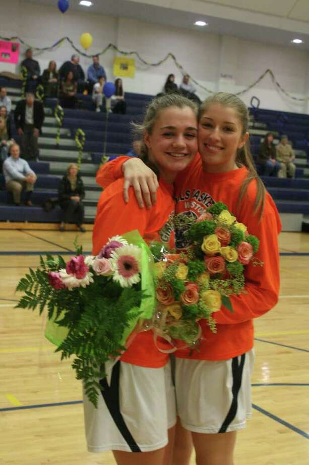 Weston's Ellie Martin, left, and Lianna Hursh, were honored on Senior Day Feb. 7 against Stratford. Martin and Hursh played their last regular season game of their careers for the Lady Trojans Tuesday, a 49-31 home loss to Joel Barlow. Photo: Contributed Photo