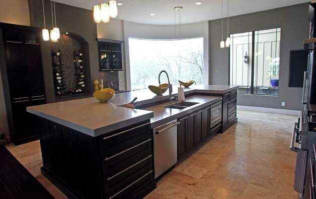 The Crowleys' kitchen features Caesarstone quartz countertops. Brad likes its durability and color choices. Photo: TOM REEL, San Antonio Express-News / San Antonio Express-News