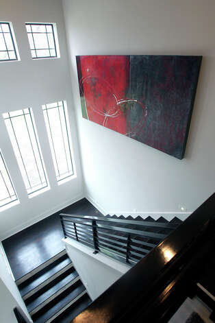 Artwork of Ben Mata on staircase at home of Bradley and Terrilyn Crowley on February 15, 2012 Tom Reel/ San Antonio Express-News Photo: TOM REEL, San Antonio Express-News / TREEL@EXPRESS-NEWS.NET