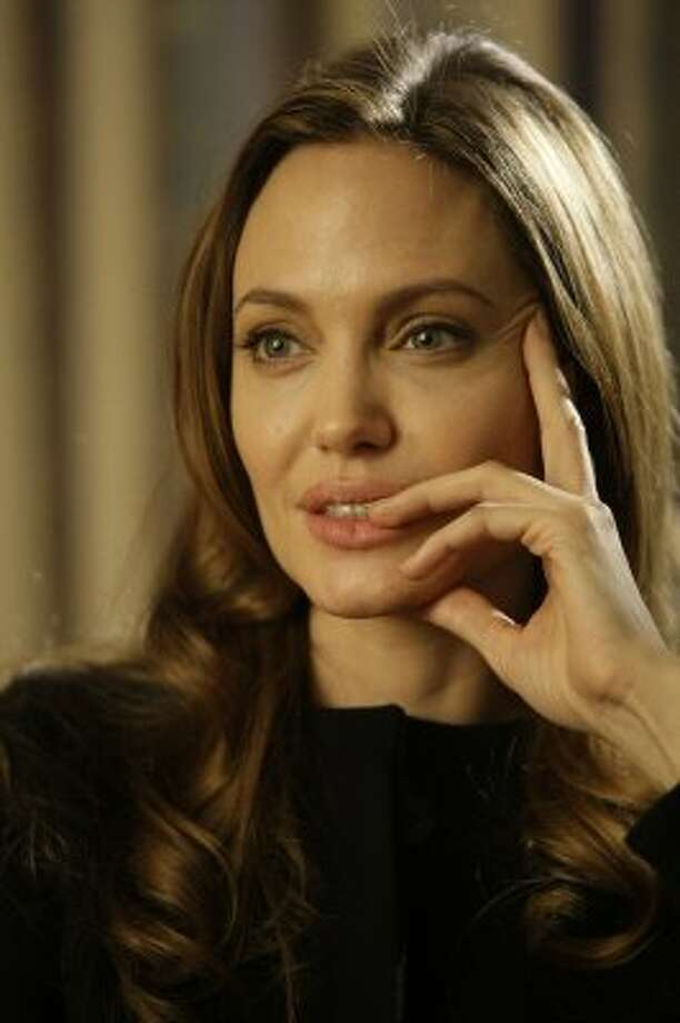 Angelina Jolie has struggled with drug and alcohol addiction but has since turned her attention toward raising her family and philanthropy.  (Amel Emric / Associated Press)