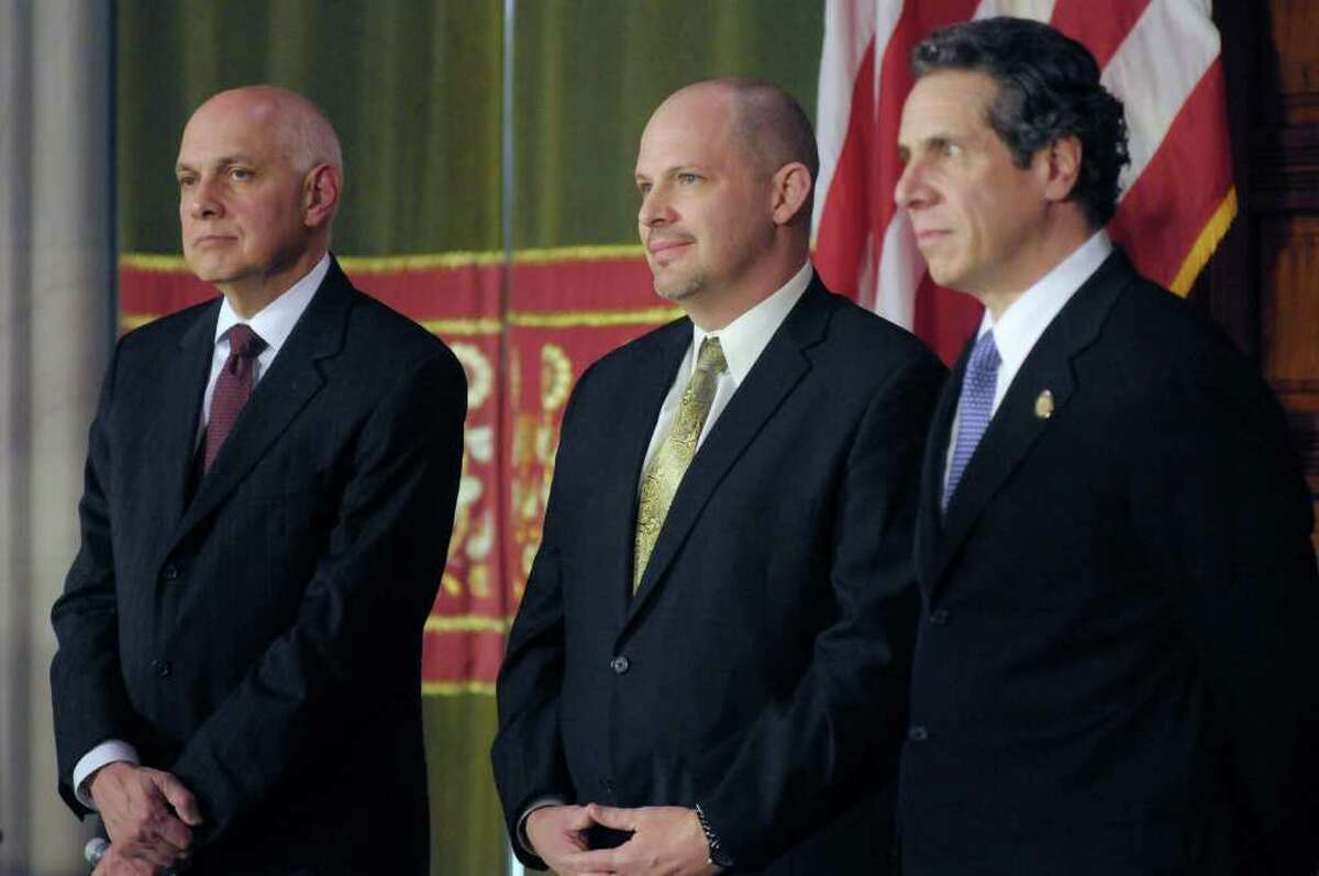 Richard Iannuzzi, left, president of New York State United Teachers, Michael Mulgrew, center, president of the United Federation of Teachers, and Governor Andrew Cuomo listen as John King, Jr., commissioner of education for New York State addresses those gathered during a press conference at the capitol on Thursday, Feb. 16, 2012 in Albany, NY. The press conference was held to announce an agreement on a teacher evaluation system for the state. (Paul Buckowski / Times Union)