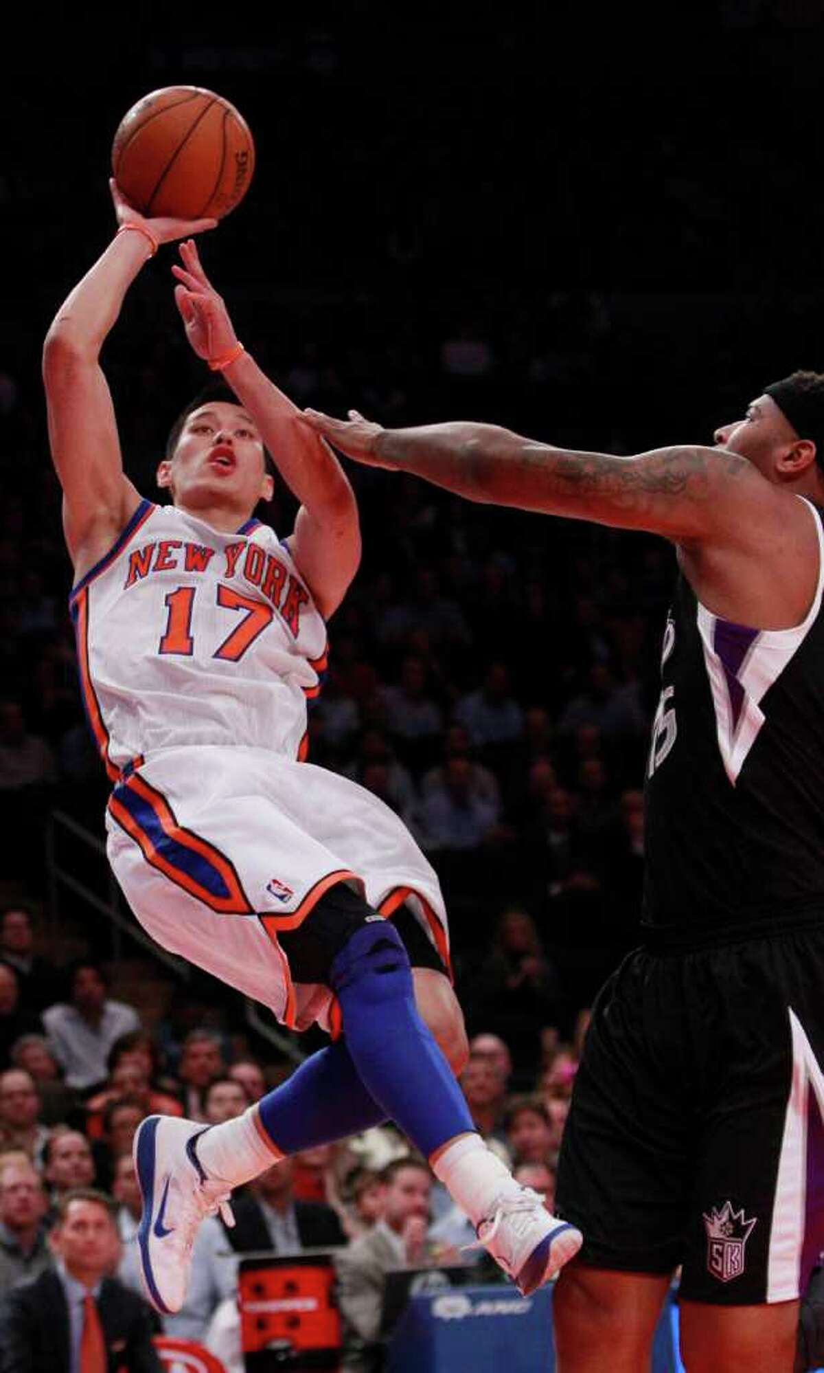 New York Knicks' Jeremy Lin (17) shoots over Sacramento Kings' DeMarcus Cousins during the first half of an NBA basketball game on Wednesday, Feb. 15, 2012, in New York. (AP Photo/Frank Franklin II)