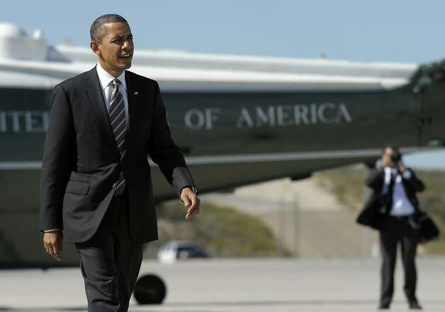 President Barack Obama walks off of Marine One and heads to Air Force One at Los Angeles International Airport in Los Angeles, Thursday, Feb. 16, 2012. Obama is heading to San Francisco to attend fundraisers. (AP Photo/Susan Walsh) Photo: Susan Walsh, Associated Press