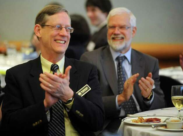 Dean of Students Robert Baer, left, claps during the annual Legislative Breakfast at Norwalk Community College on Wednesday, February 15, 2012. Photo: Lindsay Niegelberg / Stamford Advocate