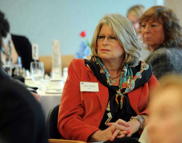 Kathy Coppola, Early Childhood Coordinator, listens during the annual Legislative Breakfast at Norwalk Community College on Wednesday, February 15, 2012. Photo: Lindsay Niegelberg / Stamford Advocate