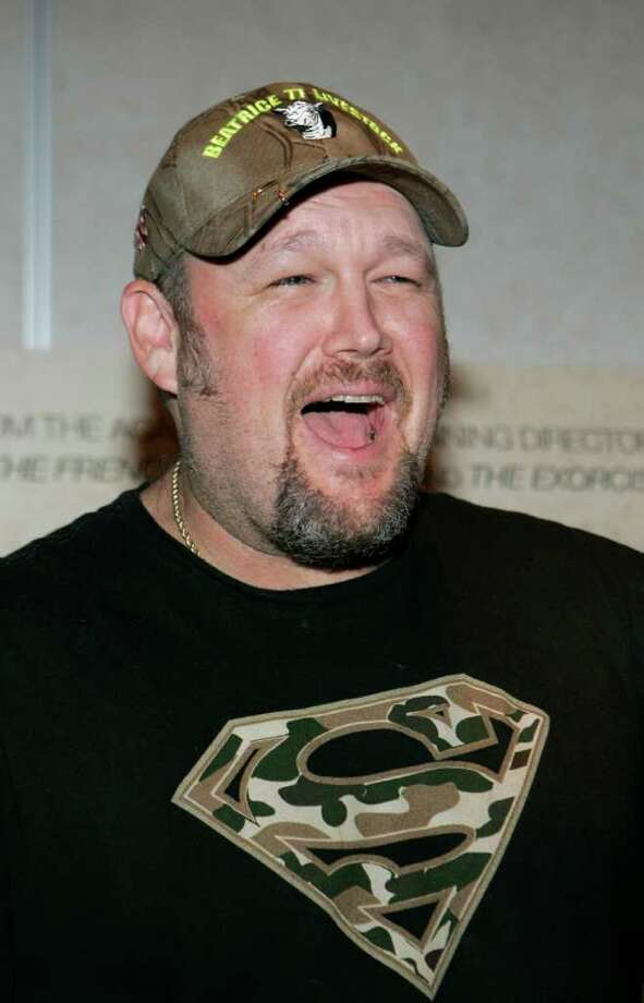 **FILE**Comedian Larry the Cable Guy arrives for a luncheon at the ShoWest convention in Las Vegas on  March 14, 2007.  Git-R-Done beer, named for the comedian's catch phrase Saturday, June 30, 2007,, by SchillingBridge Winery & MicroBrewery, from Pawnee City, Neb., the small town where the 44-year-old comedian grew up. (AP Photo/Jae C. Hong) Photo: Jae C. Hong / AP