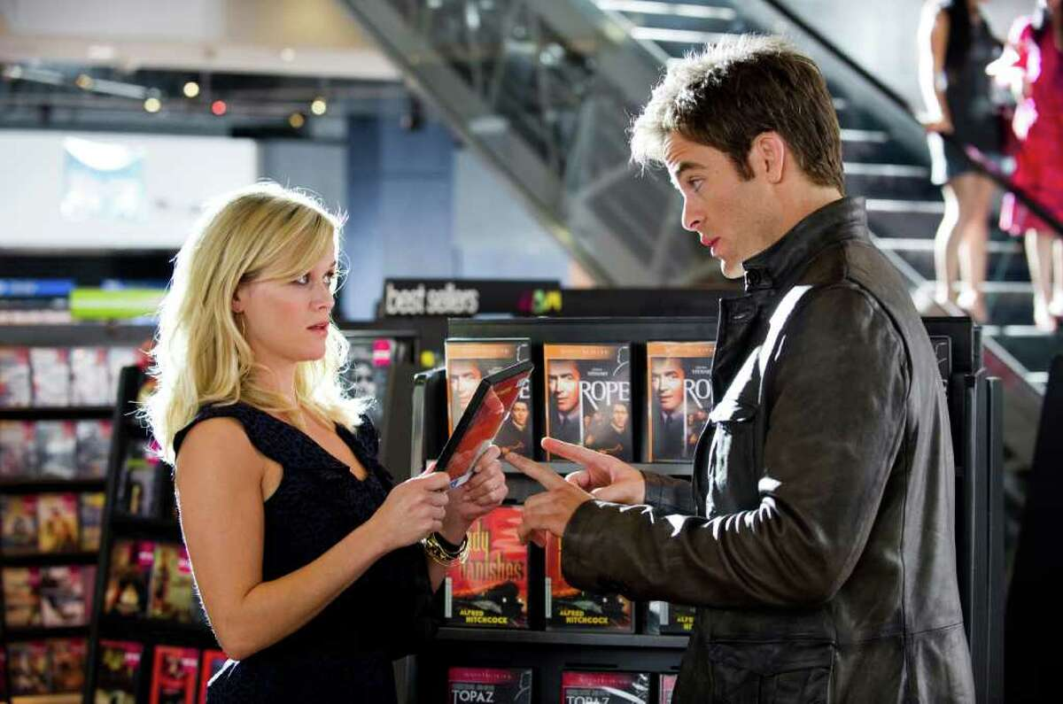 """In this film image released by 20th Century Fox, Reese Witherspoon, left, and Chris Pine are shown in a scene from """"This Means War."""" (AP Photo/20th Century Fox, Kimberley French)"""