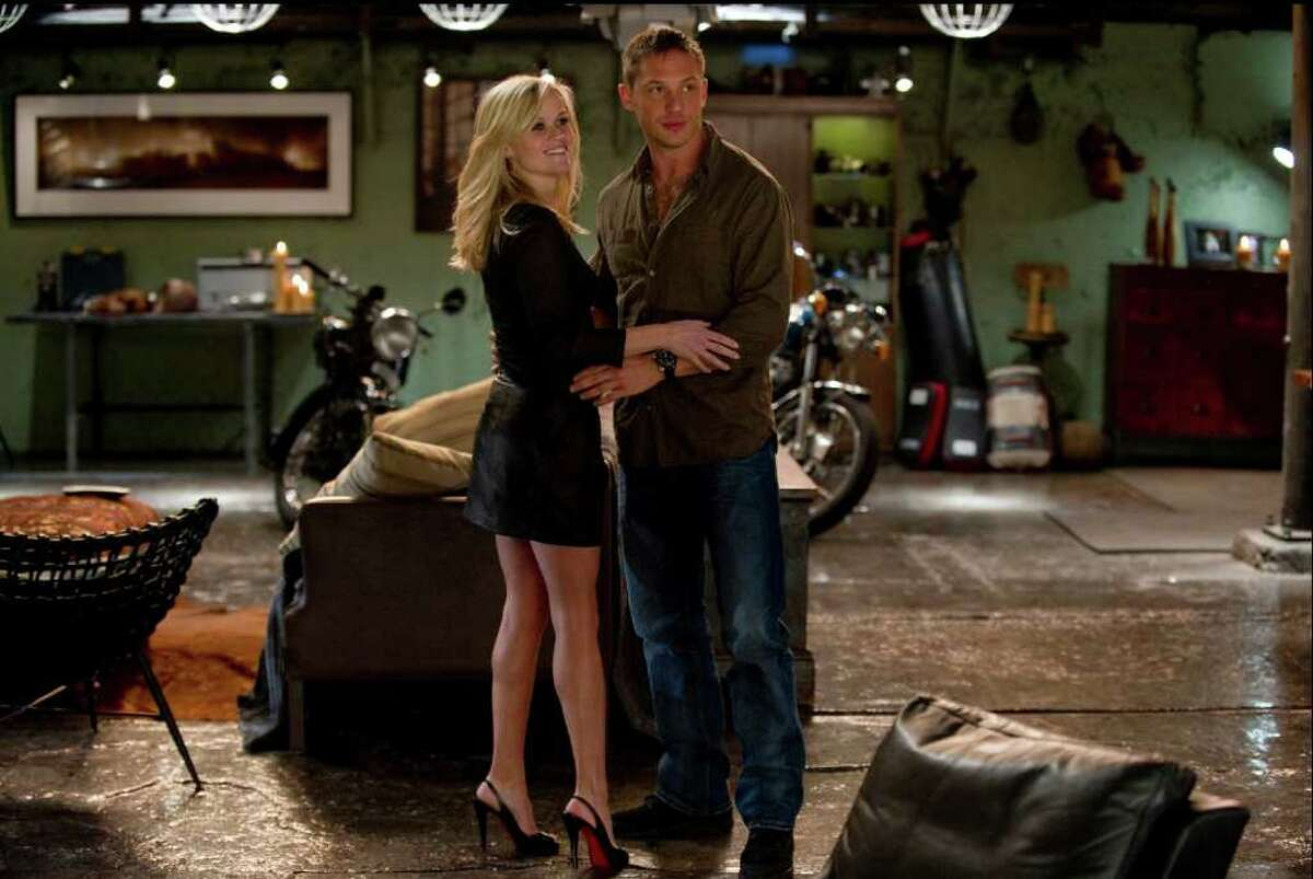 """In this film image released by 20th Century Fox, Reese Witherspoon, left, and Tom Hardy are shown in a scene from """"This Means War."""" (AP Photo/20th Century Fox, Kimberley French)"""