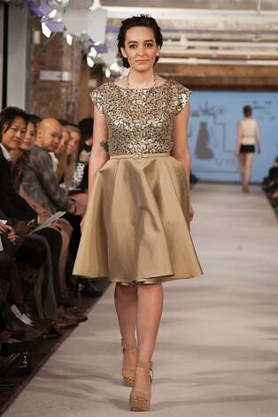 Calivintage blogger Erin Hagsrom, of Oakland, walks down the runway at the PolyvoreLive fashion show in New York, an event that was live streamed as part of Mercedes-Benz Fashion Week. Photo: Polyvore