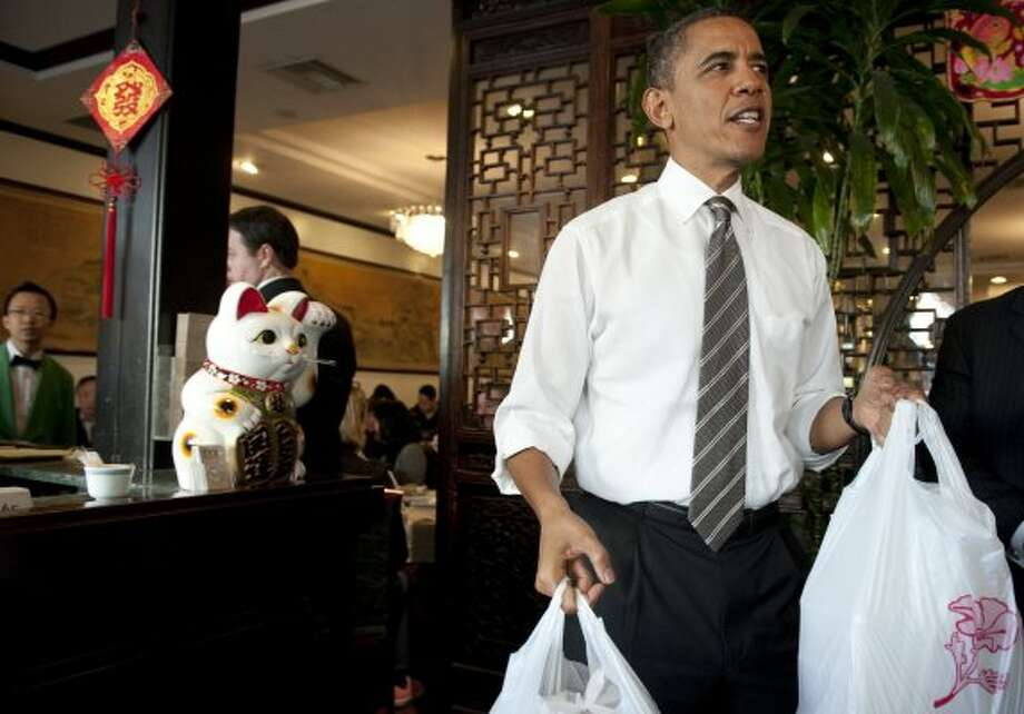 President Barack Obama carries out lunch during a surprise visit to Great Eastern. (Saul Loeb / AFP/Getty Images)