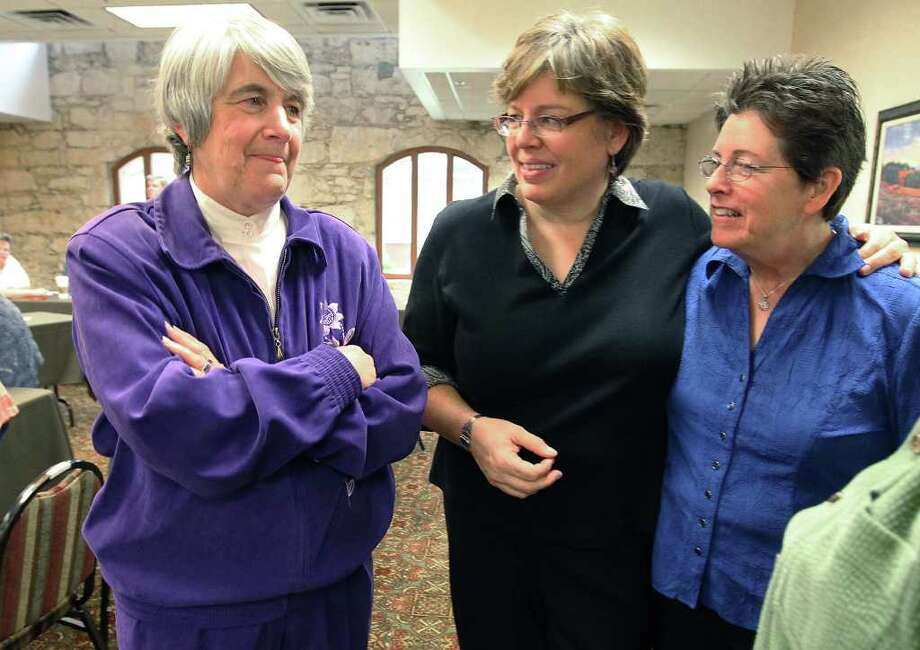 Presbyterian minister Jane Spahr (left) is in San Antonio for a hearing to appeal an earlier conviction of censure by the Presbyterian Church for performing same-sex marriages in California on Feb. 16, 2012. Spahr was chatting with BJ Douglass (center) and Connie Valois - a same-sex couple that she married in California in 2008. Photo: Kin Man Hui, San Antonio Express-News / San Antonio Express-News