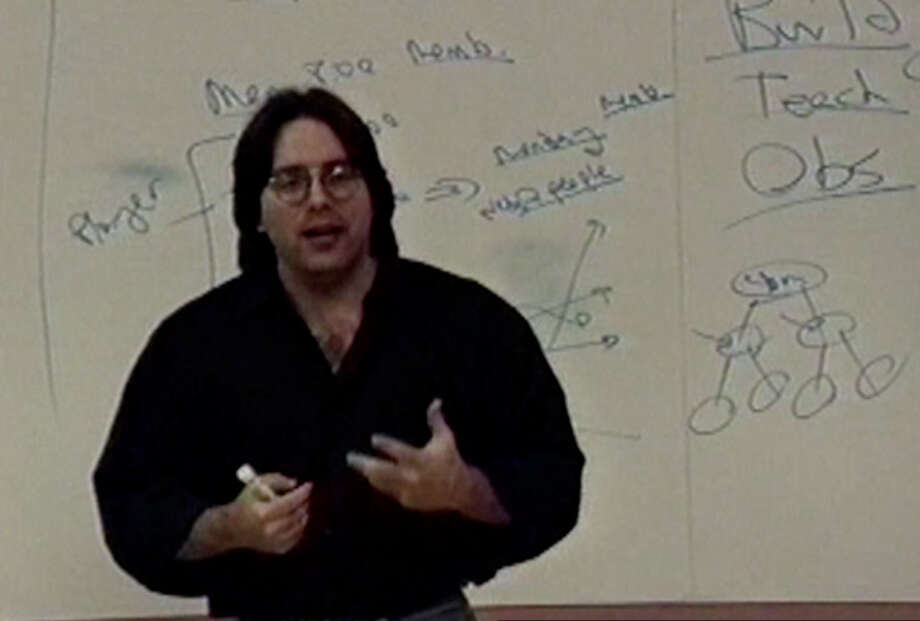 Keith Raniere describes his multi-level marketing strategy for Innovative Network, a short-lived business, to a small audience in Clifton Park in November 1997. Raniere's associates would frequently record his every speech.