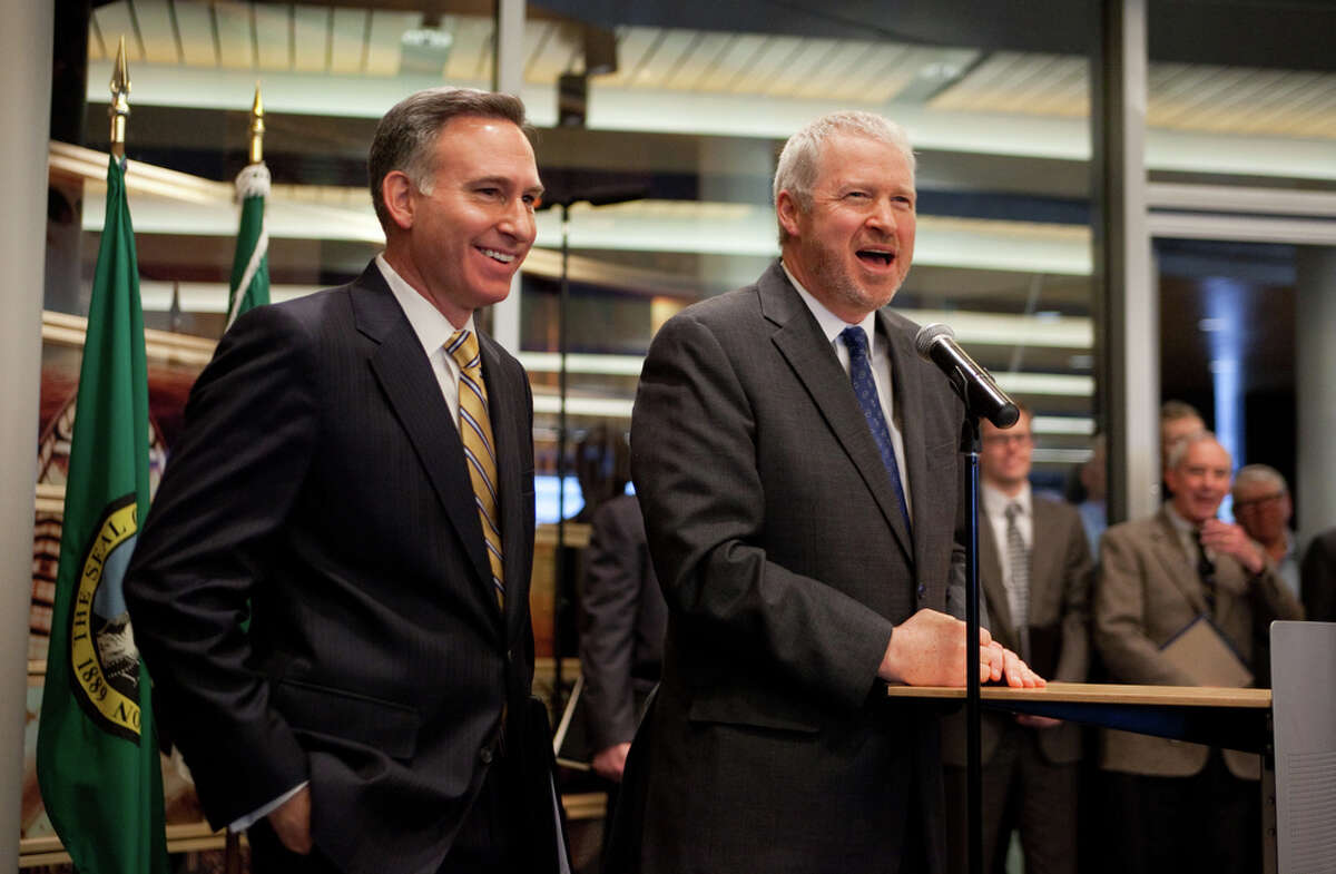 King County Executive Dow Constantine, left, and Seattle Mayor Mike McGinn speak during a press conference on Thursday February 16, 2012 at Seattle City Hall where they announced a possible deal on a new arena for an NBA team and NHL team in Seattle's Sodo neighborhood.