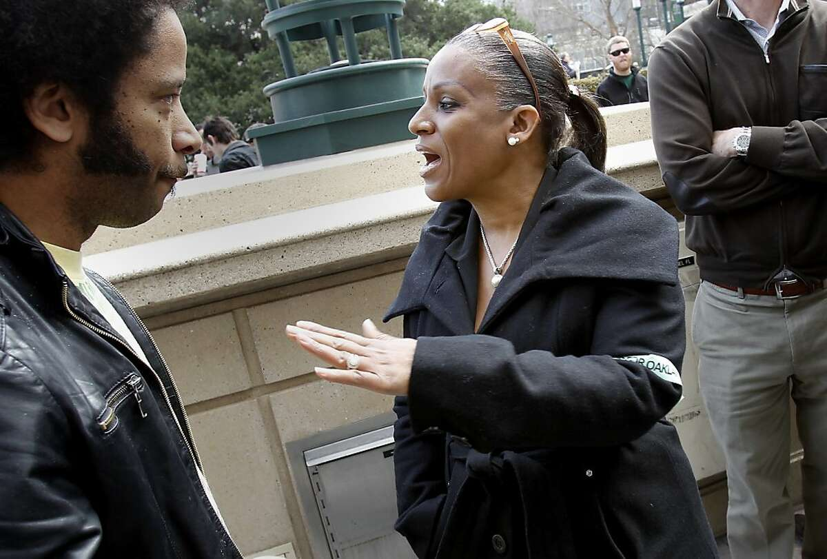 Desley Brooks (center), who sits on the Oakland City Council, stopped to talk with a member of the Occupy movement during a rally by Occupy and anti-Occupy forces in front of Oakland City Hall Monday February 6, 2012.