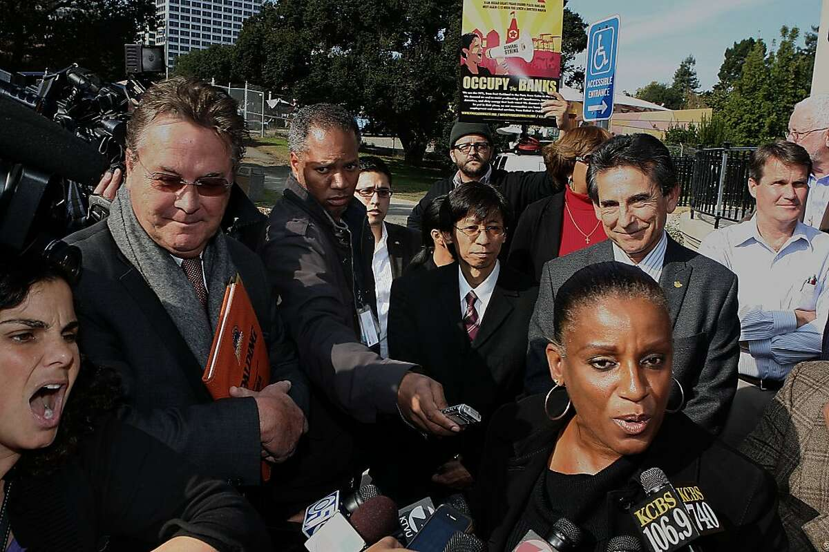Oakland city council member Desley Brooks (right) tries to talk to press over the chants of Debra Grabelle (left) in solidarity with Occupy Oakland at the bandstand next to Lake Merritt in Oakland, Calif., on Wednesday, November 9, 2011