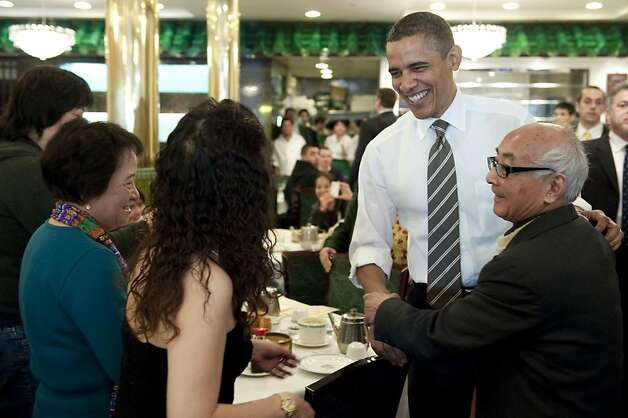 US President Barack Obama greets patrons during a surprise visit to Great Eastern Restaurant for dim sum in San Francisco's Chinatown on February 16, 2012.       TOPSHOTS/AFP PHOTO/Saul LOEB (Photo credit should read SAUL LOEB/AFP/Getty Images) Photo: Saul Loeb, AFP/Getty Images