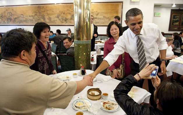 US President Barack Obama greets patrons during a surpise visit to Great Eastern Restaurant for dim sum in San Francisco's Chinatown on February 16, 2012.     AFP PHOTO/Saul LOEB (Photo credit should read SAUL LOEB/AFP/Getty Images) Photo: Saul Loeb, AFP/Getty Images