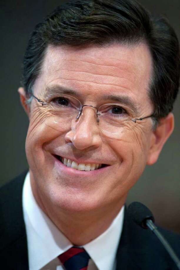 "FILE-  This Thursday, June 30, 2011 file photo shows comedian Stephen Colbert as he appears before the Federal Election Commission in Washington. Comedy Central's ""Colbert Report"" is currently off the air. An expected live version of the show was replaced by a repeat on Wednesday. Comedy Central said Thursday's live show will be off, too. The network said it was airing the repeats ""due to unforeseen circumstances,"" but offered no other explanation.  (AP Photo/Cliff Owen, File) Photo: Cliff Owen"