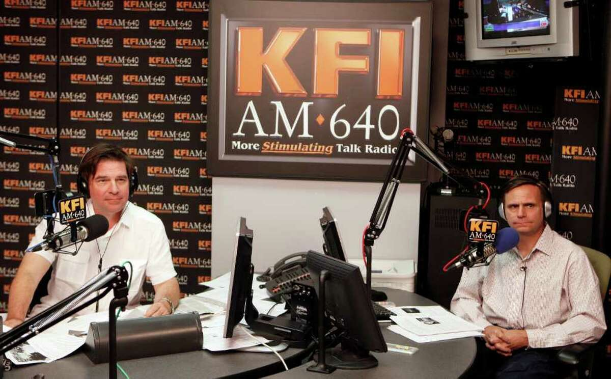 """In this March 9, 2011 file photo, KFI AM 640 Radio's John Kobylt, left, and Ken Chiampou, record their radio show at their station in Burbank, Calif. The station said in a statement that Kobylt and Chiampou were """"suspended for making insensitive and inappropriate comments about the late Whitney Houston."""" Kobylt said in statement that they """"used language that was inappropriate?"""" and they ?""""sincerely apologize to our listeners and to the family of Ms. Houston."""" The hosts, who often rail against taxes and illegal immigration, will return to the airwaves Feb. 27. (AP Photo/Damian Dovarganes)"""